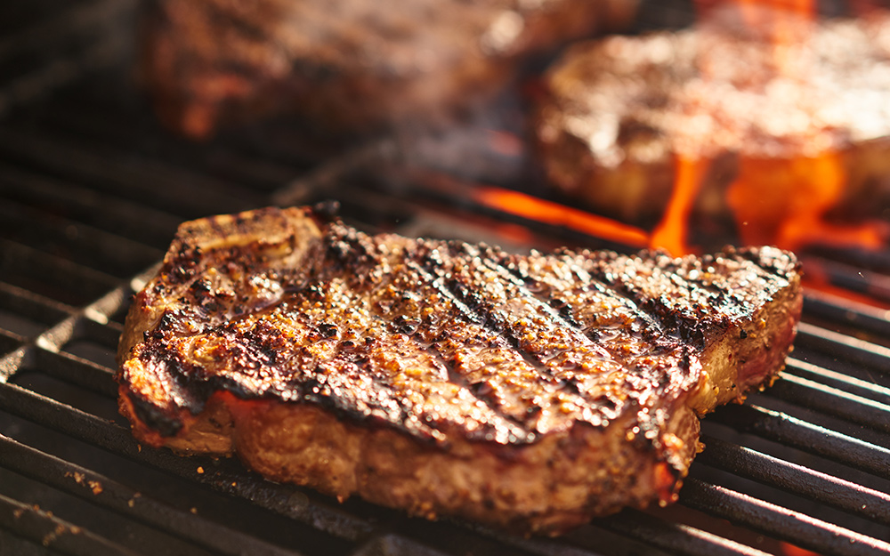 Steak searing on a hot grill.