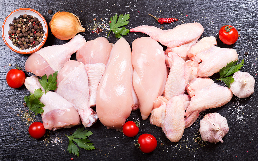 Various chicken parts on a countertop.