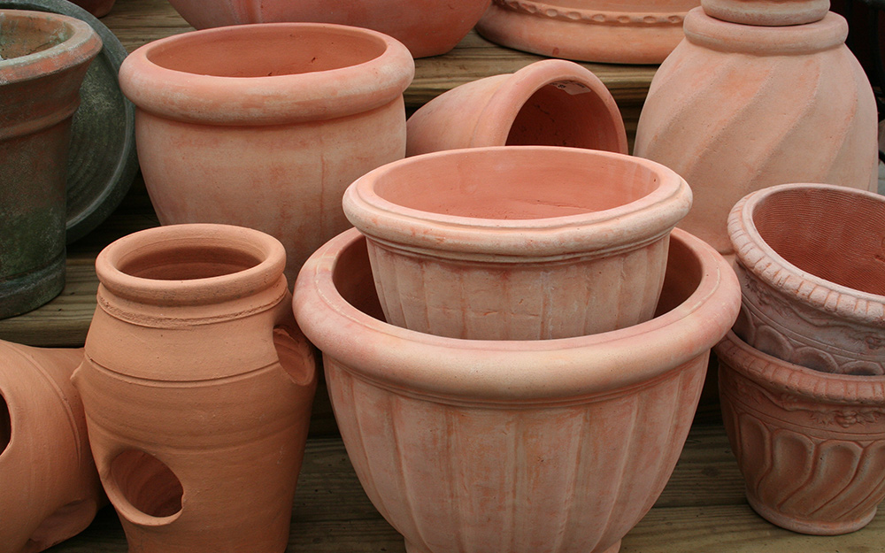 Assorted terra cotta planters in various shapes and sizes