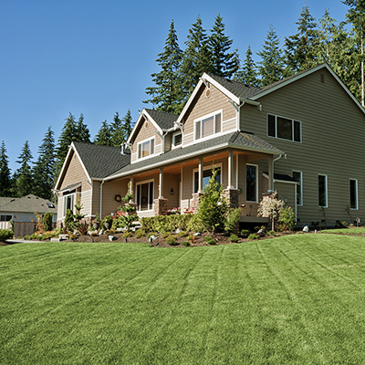 A home with a lawn of thick green grass.