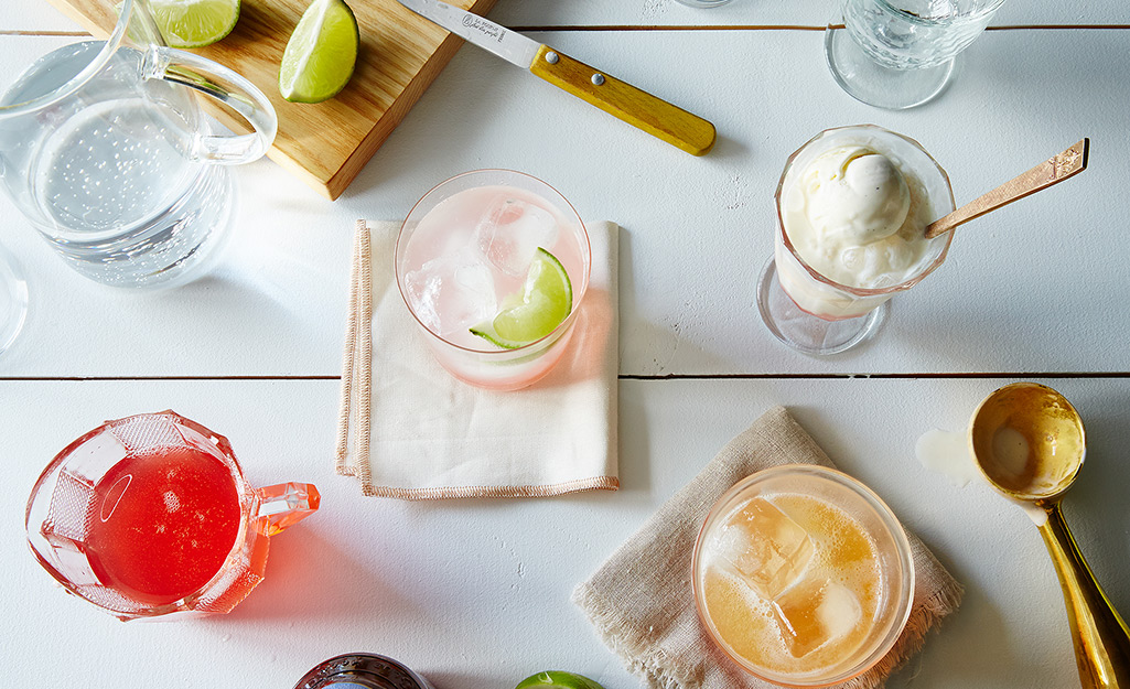 Rhubarb syrup in a glass on a white napkin