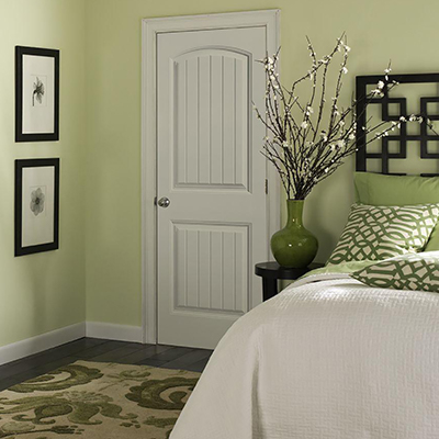 a white interior door in a bedroom