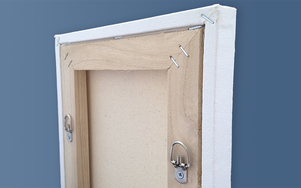 Two D-rings attached to the back of a picture frame.