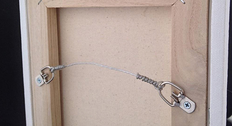 Double Wire Hanging On The Back Of A Picture Frame