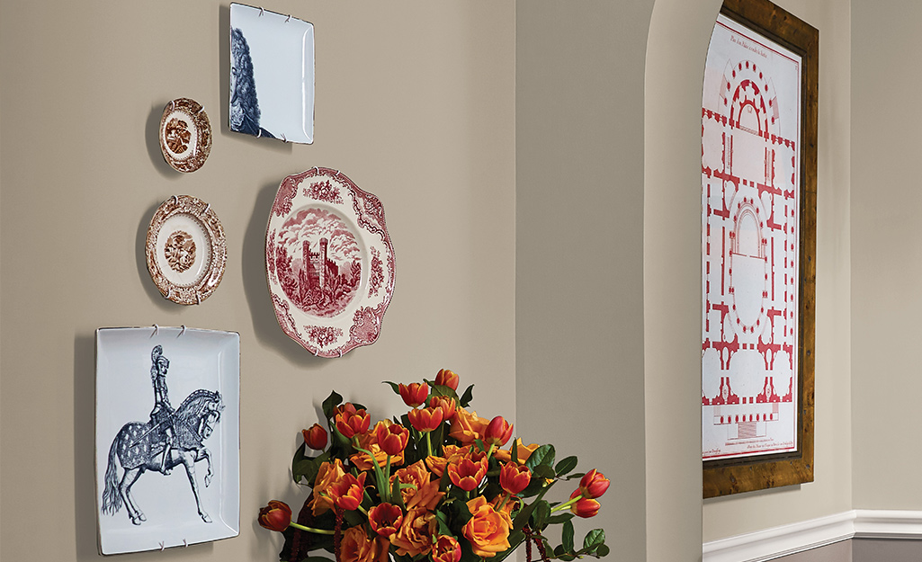 A variety of decorative plates hung on a wall.