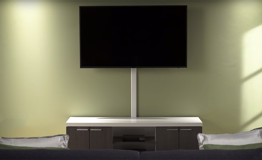 A wall-mounted tv with its wires completely hidden.