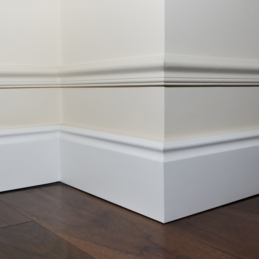 White baseboard detail on beige wall.