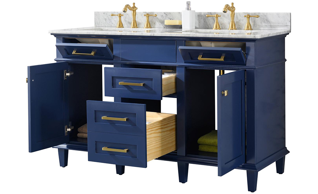 A blue bath vanity with open drawers.