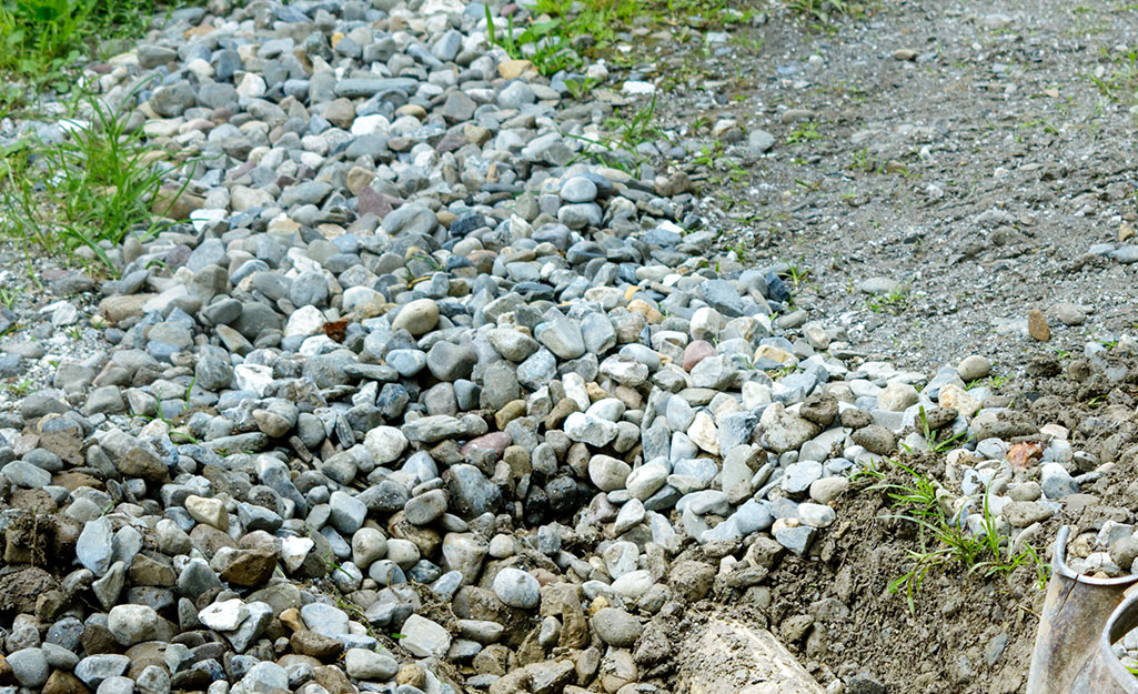A French drain system hidden underneath landscaping stones.