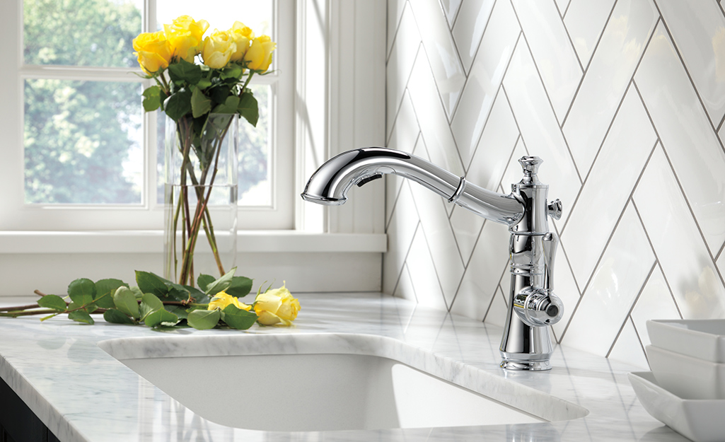 A single handle faucet in a kitchen.