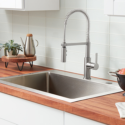 A single-handle kitchen faucet.