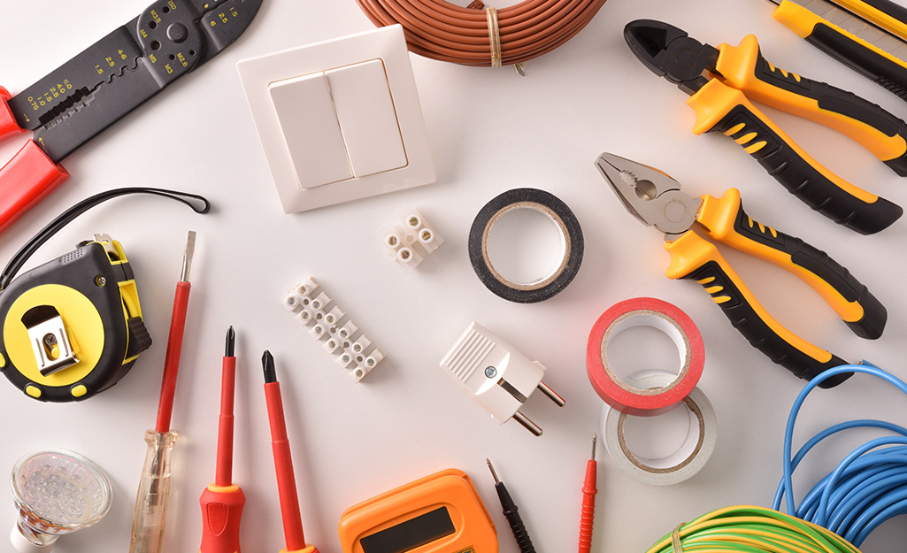 Electrical tools and equipment placed on a table.