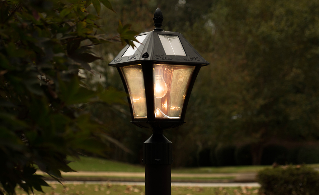 An outdoor lamp lit up at night.