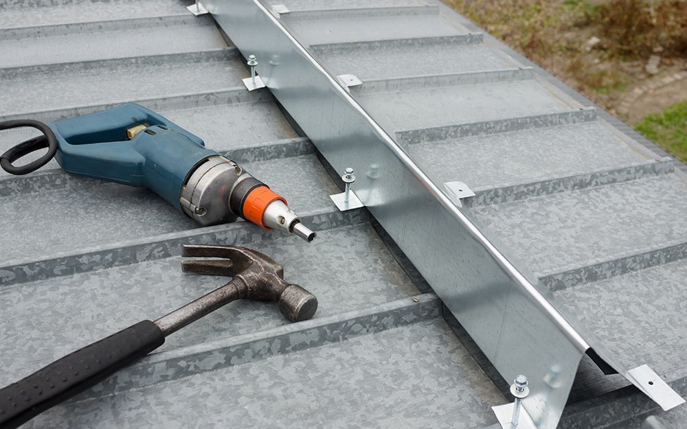 Flashing being installed on a metal roof.