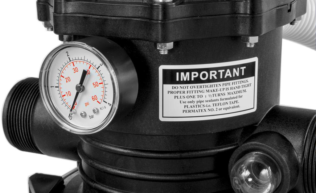 A close up of a pool filter pressure gauge.