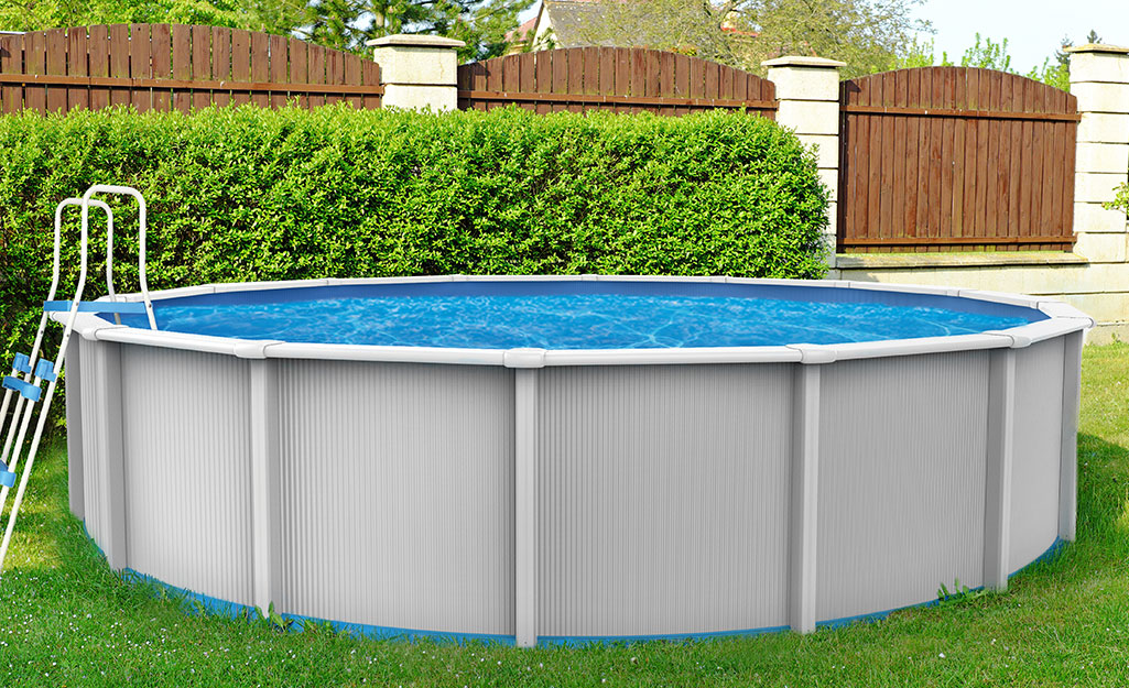 An above-ground pool in a backyard