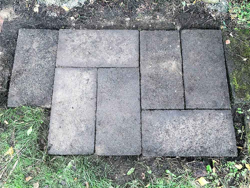 A group of pavers leveled in grass.