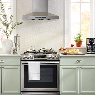A range hood is installed over a kitchen stovetop.
