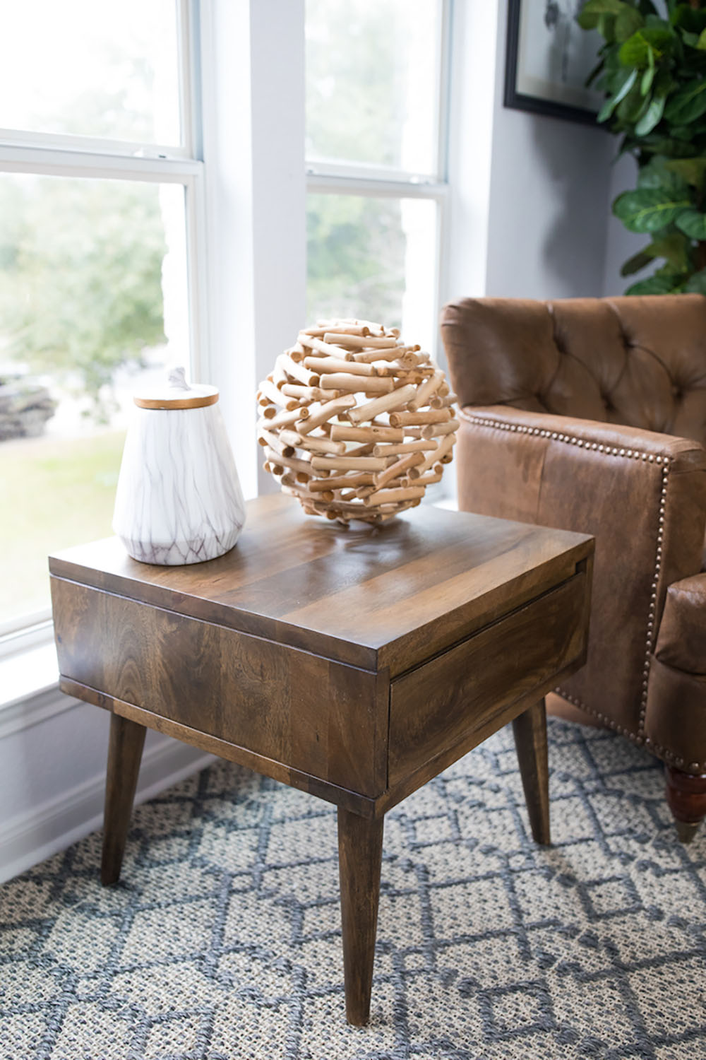 A side table with decor on top