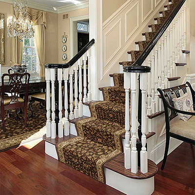 A carpet runner installed on a staircase.