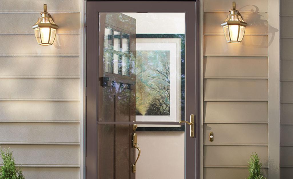 A storm door installed in front of an exterior front door.