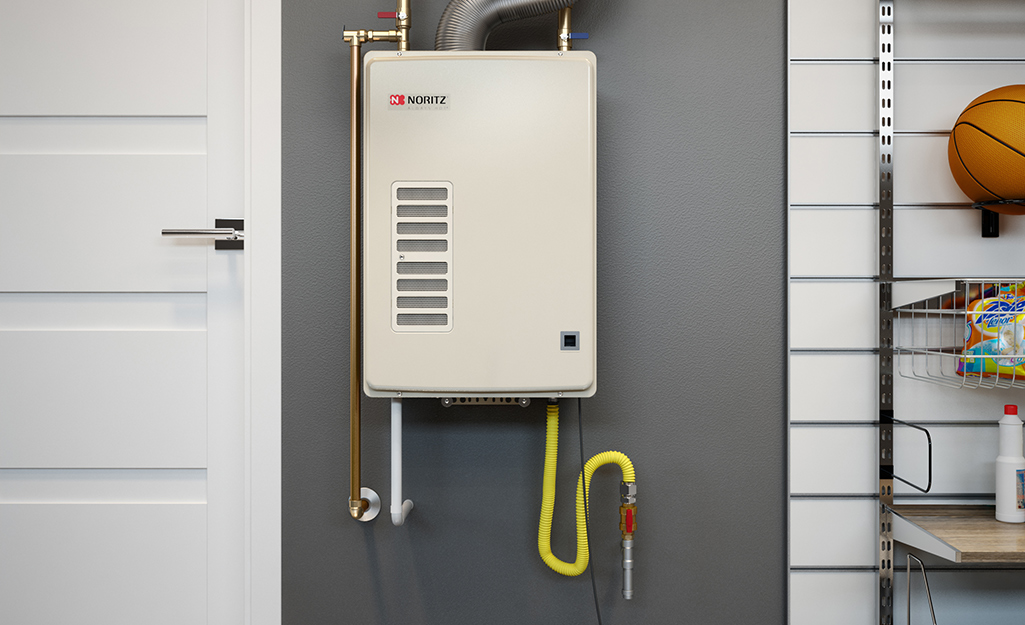 A tankless water heater mounted in a utility space.