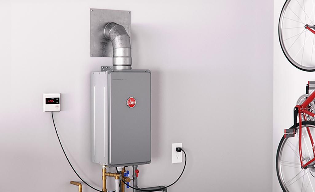 A tankless water heater mounted on a wall with the exhaust vent installed.