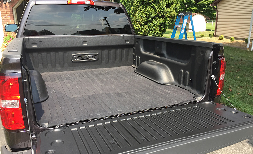the back of a truck showing an empty truck bed