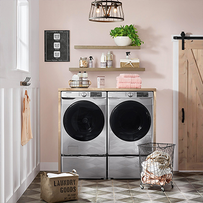 Front load washer and dryer side by side in a laundry room.