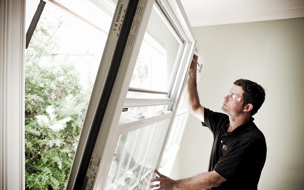 Man installing a window.