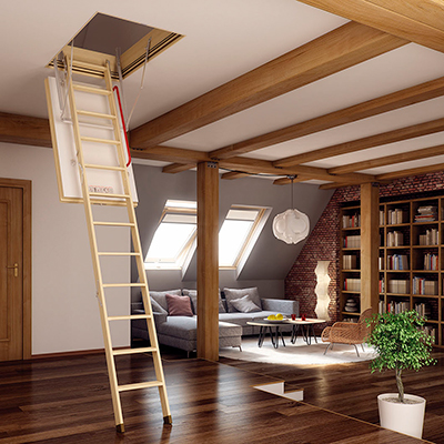 A room with an attic ladder coming down from the ceiling