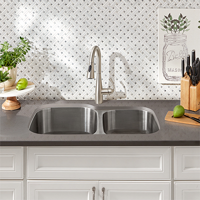 An undermount sink is built into a kitchen countertop.
