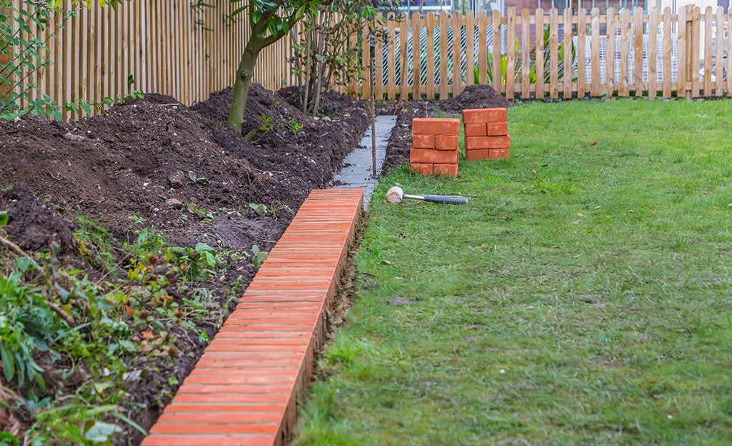How To Install Brick Edging The Home, How To Lay Brick Pavers Garden Edging