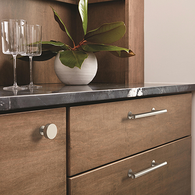 Cabinets and drawers with brushed nickel knobs and handles.
