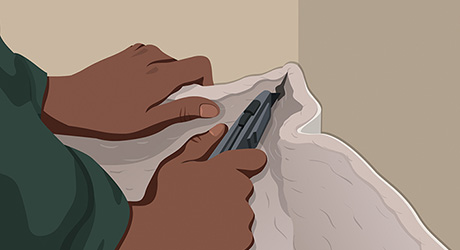 Step 4: Person Cutting Relief Cuts in Corners of Carpet with Carpet Knife