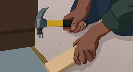 Step 15: Person Holding Hammer and Block of Wood to Make Transition Moulding