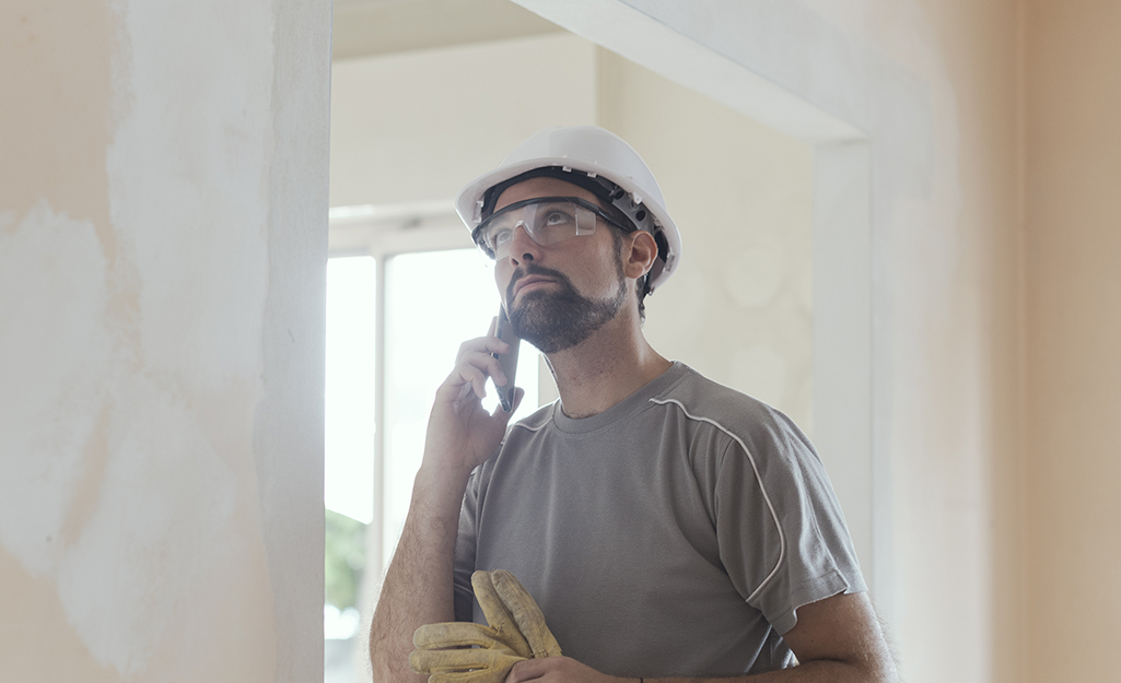 A person examines a doorway before installing trim.