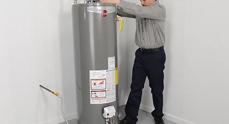 Set water heater in place - Install Gas Water Heater