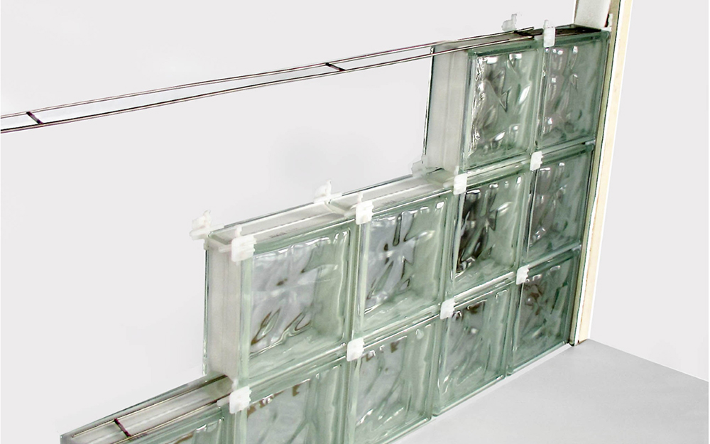 glass block wall with spacers partially installed