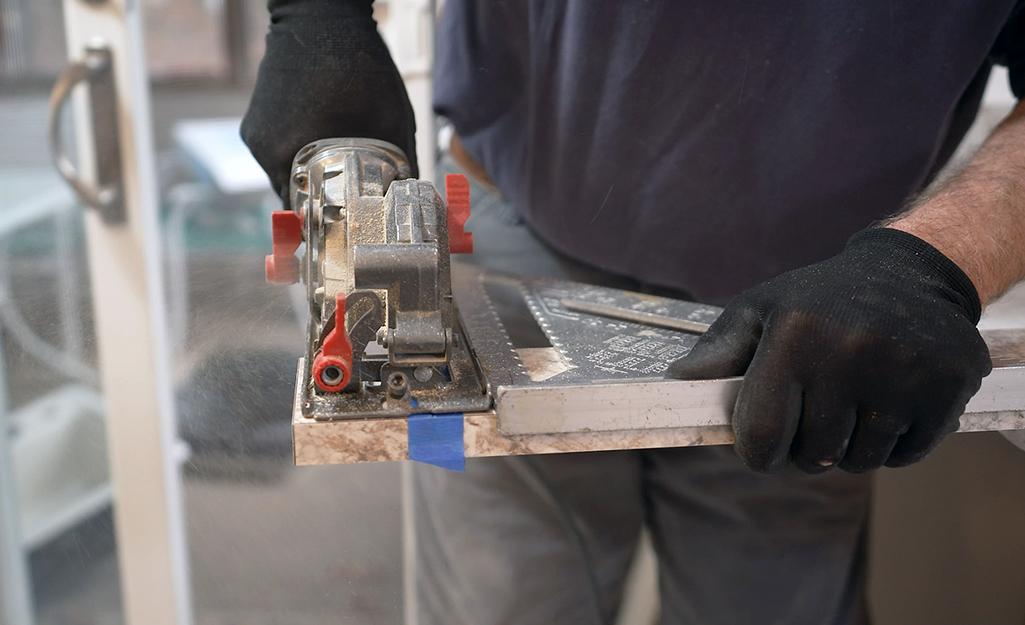 A saw is used to cut backsplash.