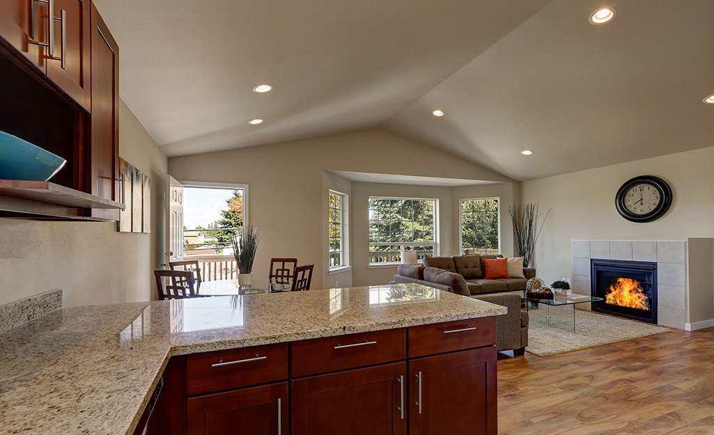 An open living room with installed recessed lighting.