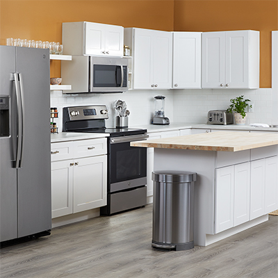 A kitchen with white cabinets.