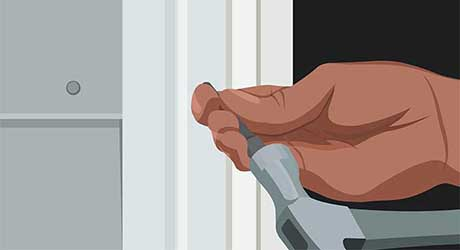 Illustration of person's hand holding a hammer and nail.