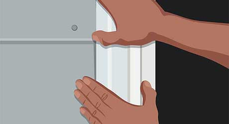 Illustration of person setting window inside window cutout area.