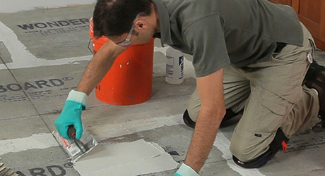 Apply mortar square-notched trowel - Laying Floor Tiles