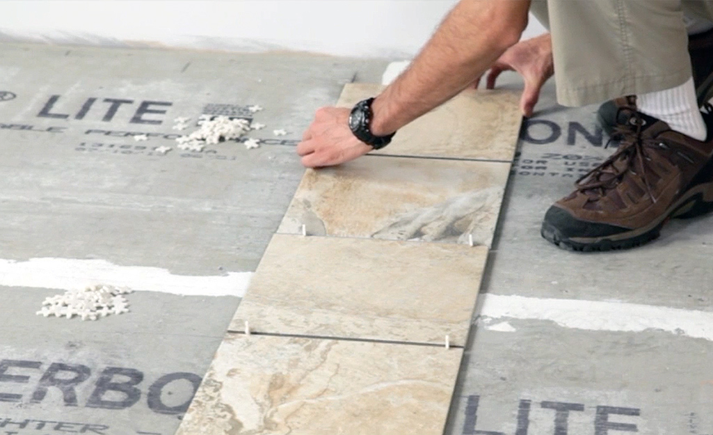 Lay First Tiles Spacers - Lay Out Floor Tiles