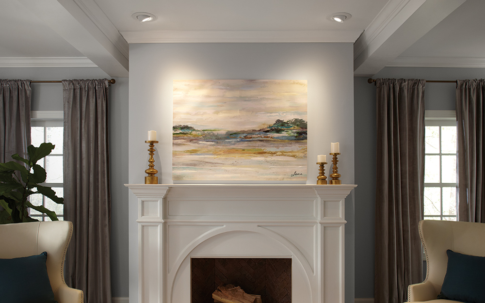 Calculate Lighting Placement Accent Recessed Highlighting A Painting Hung Over Fireplace