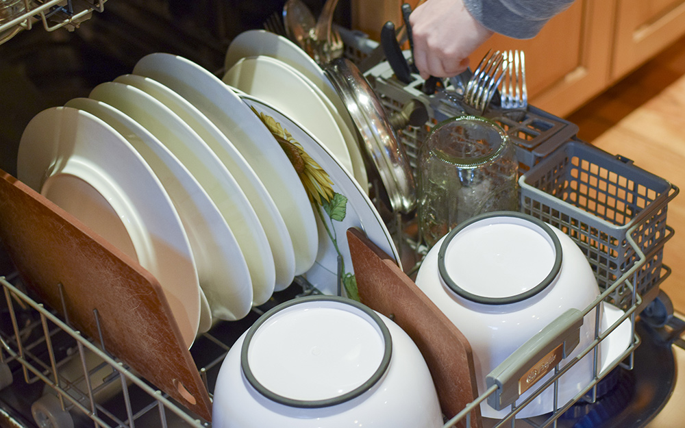 an open dishwasher showing the bottom rack full of dishes