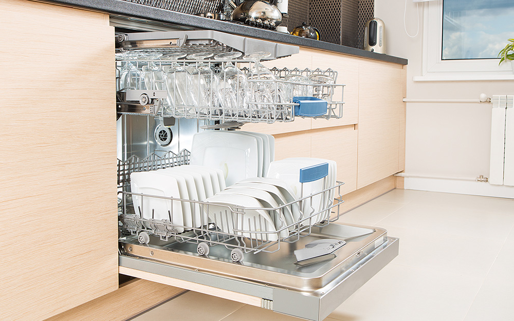 an open dishwasher full of clean dishes