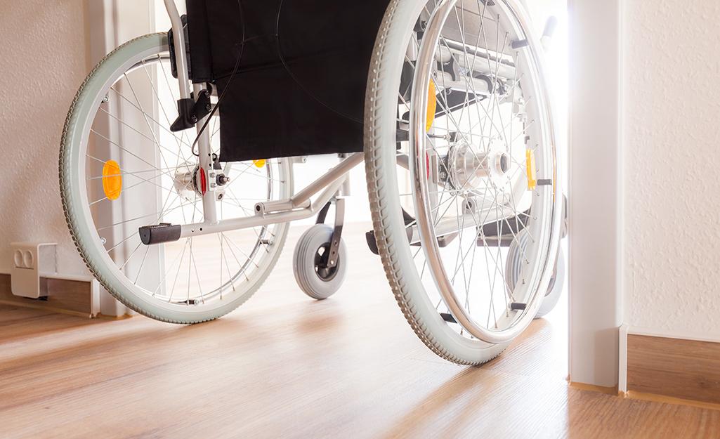 A wheelchair passing through a doorway.
